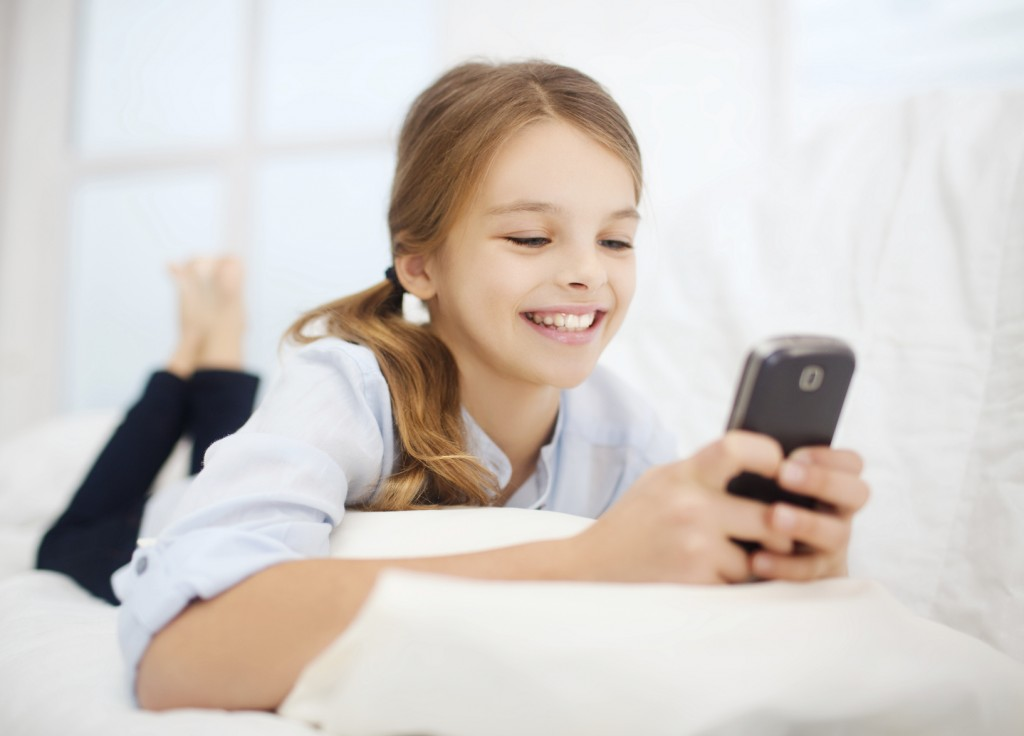 girl with smartphone at home