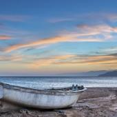 Old fishing boat at dawn