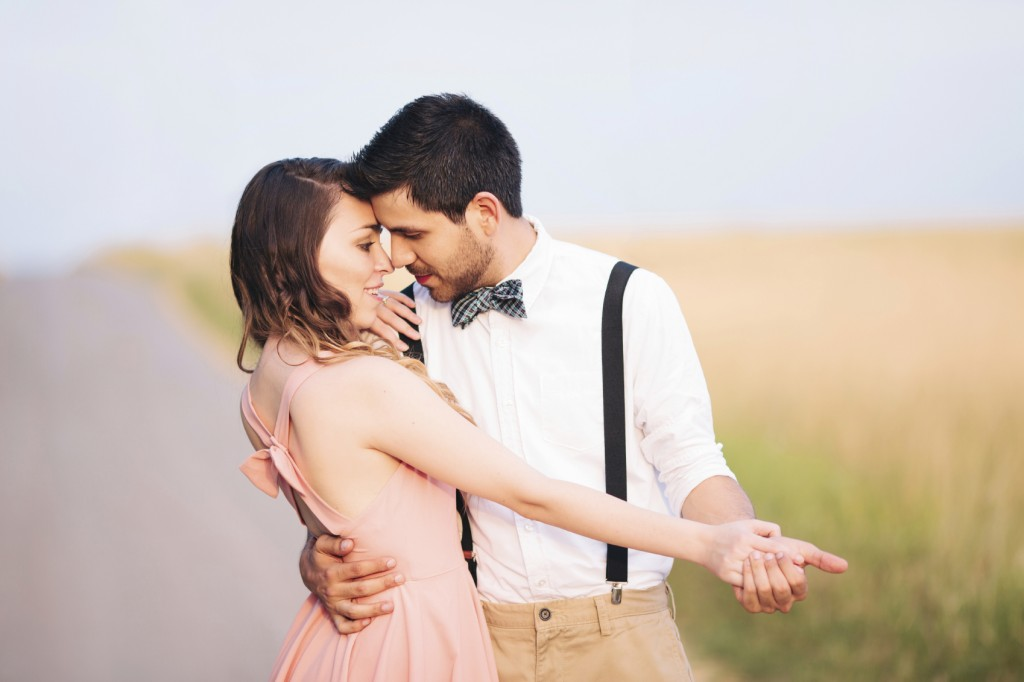 young couple dancing in a field