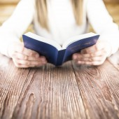 The girl reads the Bible