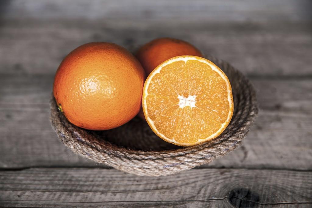 fresh, orange on a wooden background