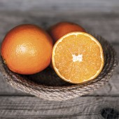 fresh, orange on a wooden background
