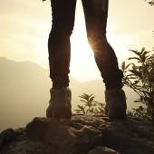 hiking feet sunrise mountain peak rock