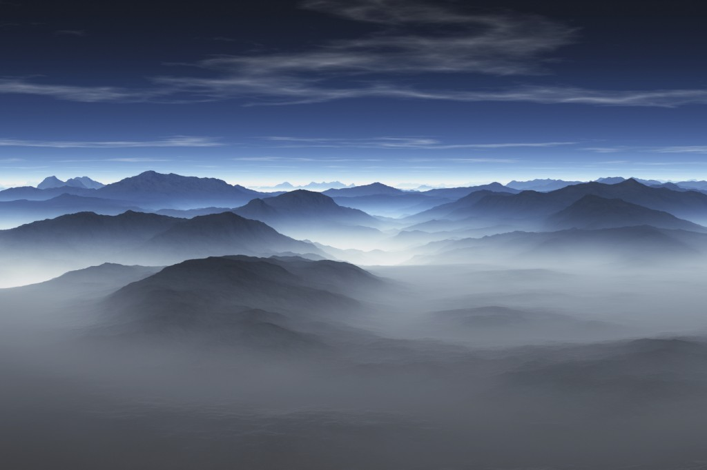 Aerial view of misty mountains, early morning.