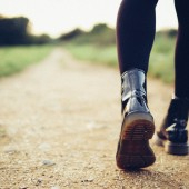 low angle of girl with black boots walking path