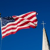 church spire and American flag