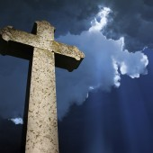 Cross under the clouds