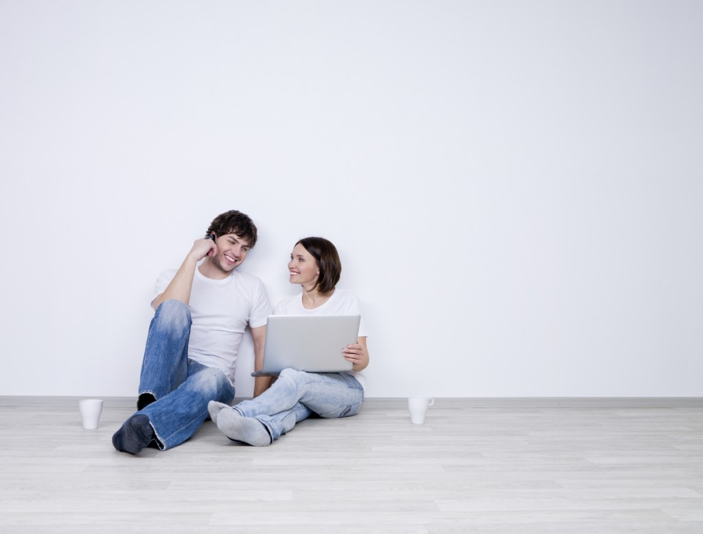 Beautiful smiling couple with laptop