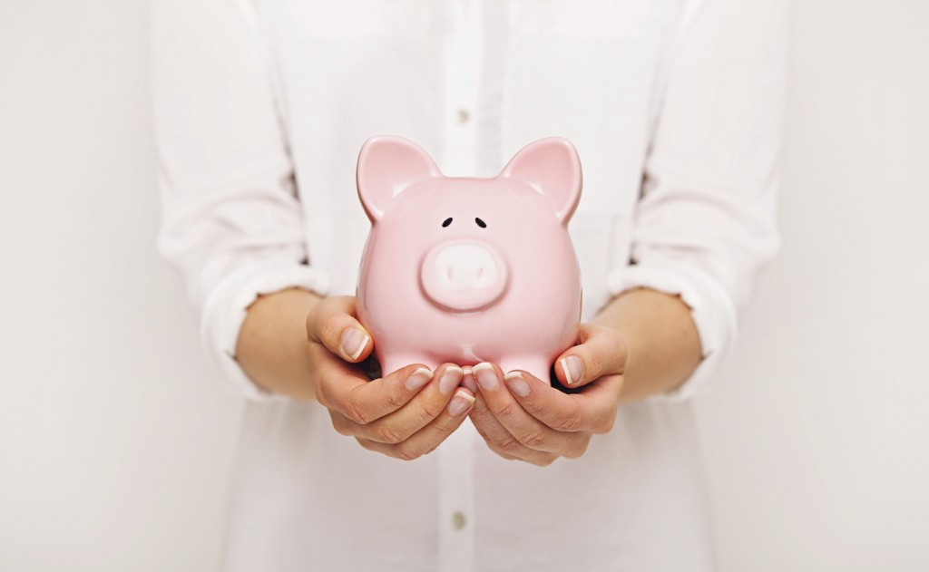 Close-up of a Piggy Bank in the Hands of a Woman