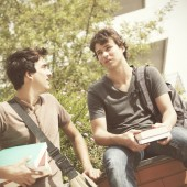 two young student talking at the school (selective focus)