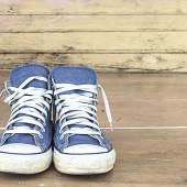 blue sneakers on the wooden floor, vintage