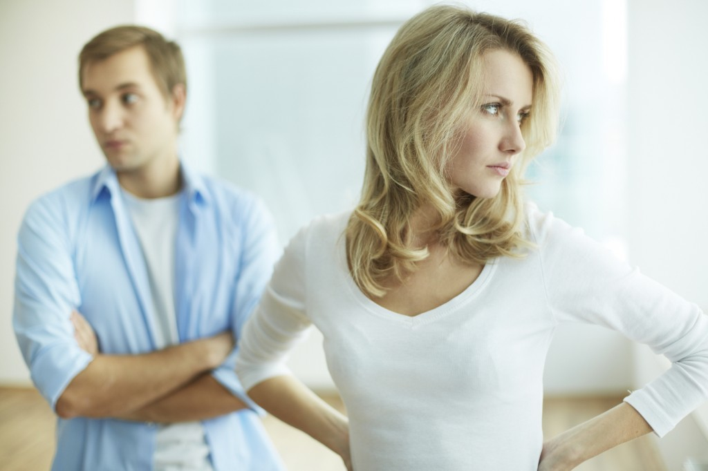 young upset female in quarrel with her husband