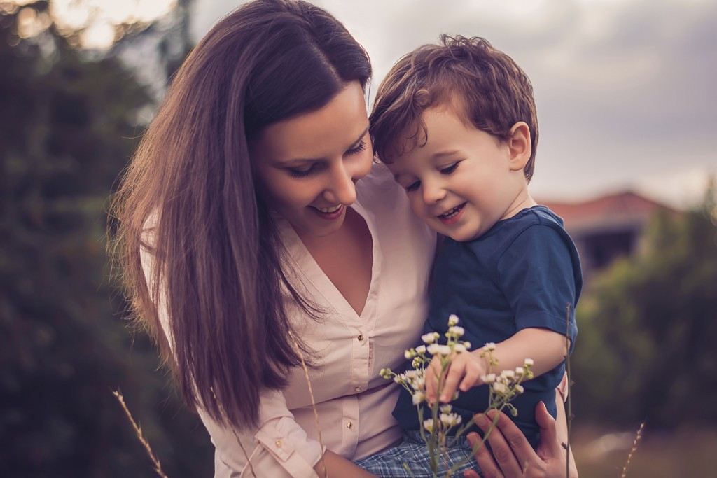 Mother and son looking at flowers