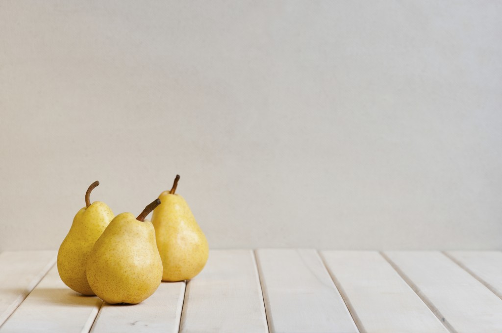 Yellow pears on the white table