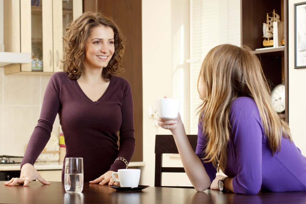 two friends having coffee and chatting