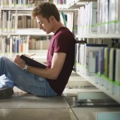 guy studying in library