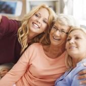Blonde girl taking selfie with mom and grandma