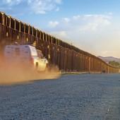 Border patrol trucks driving to catch illegal alien