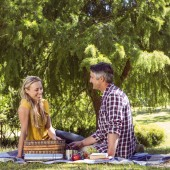 Couple having a picnic in the park