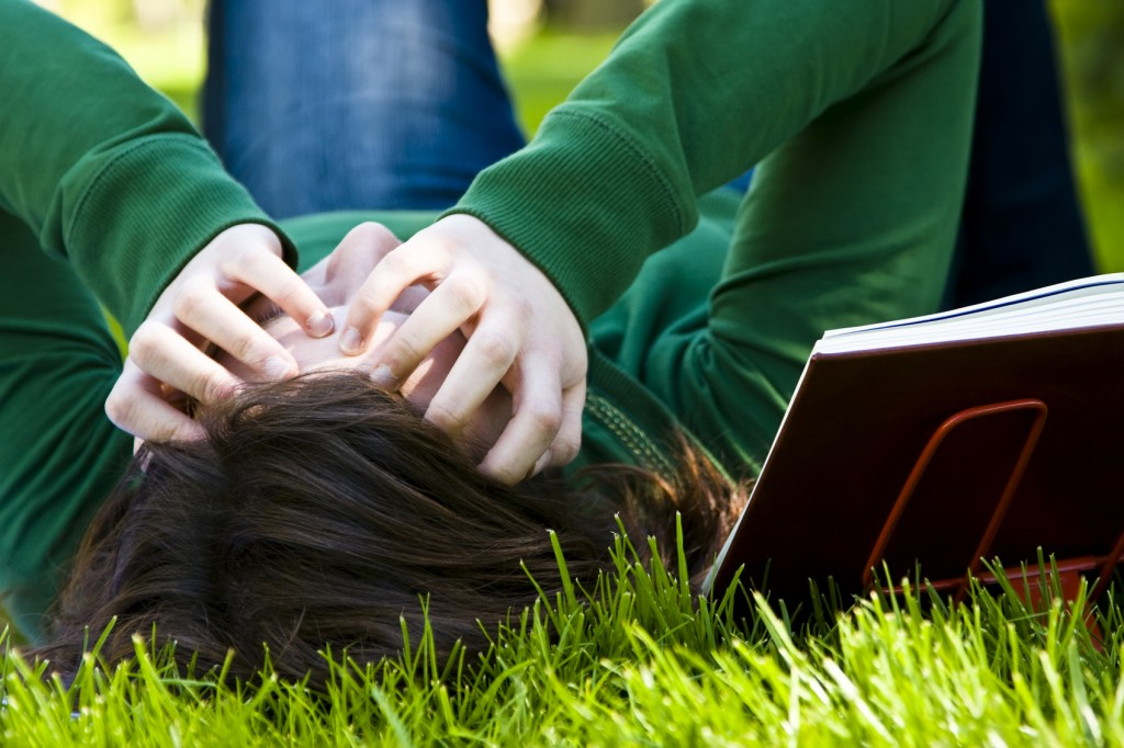 Exhausted student over the grass in the park