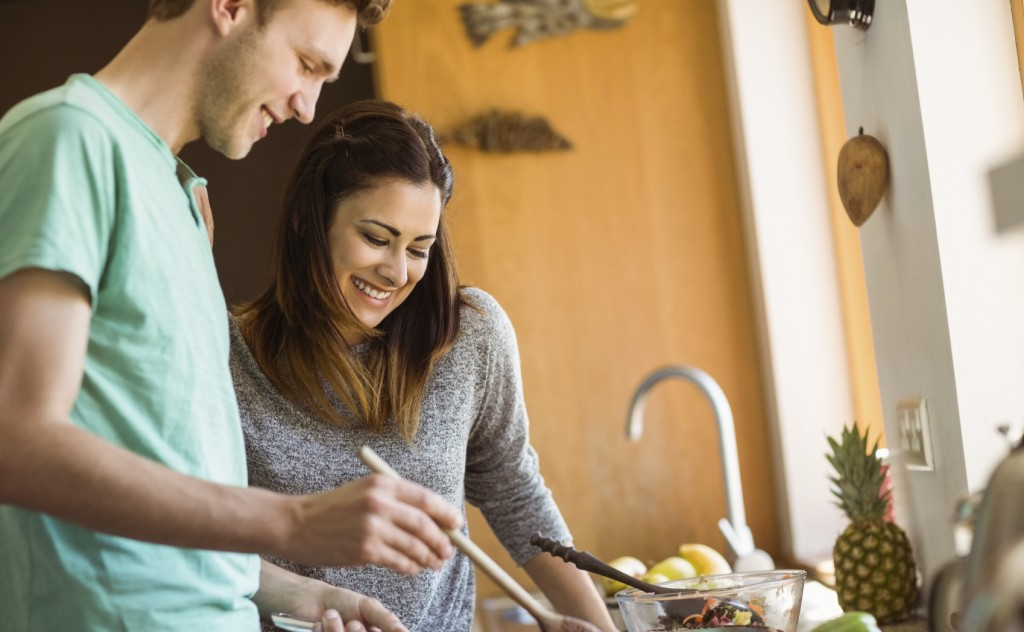 Cute couple preparing food together