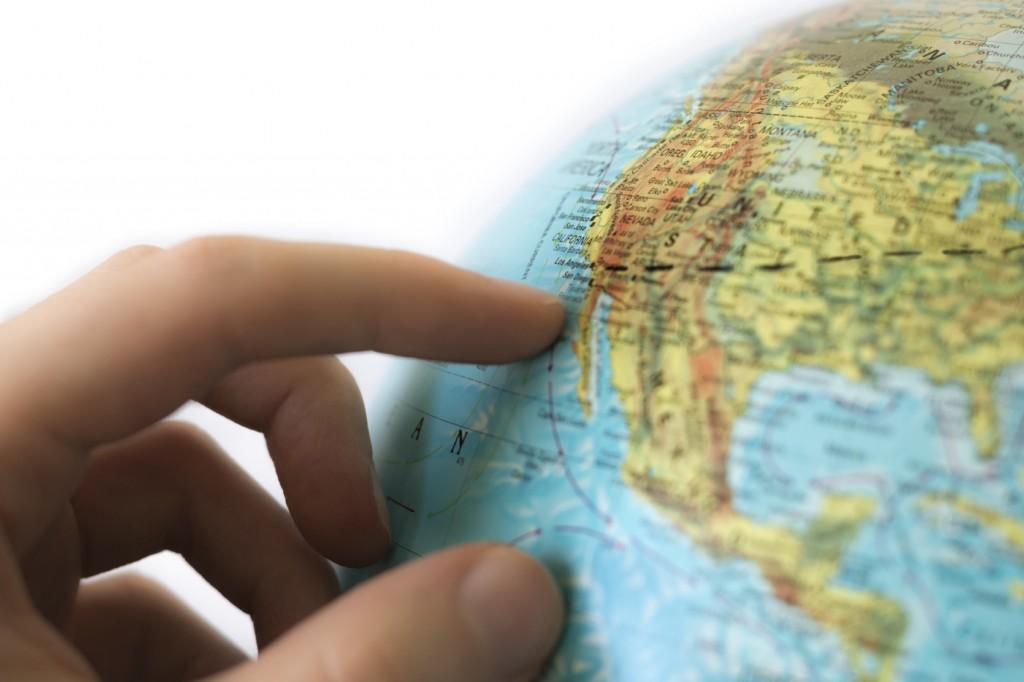 Hand Touching Globe