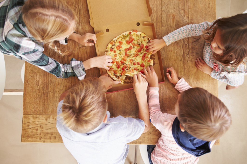 Children sharing a pizza together, overhead view