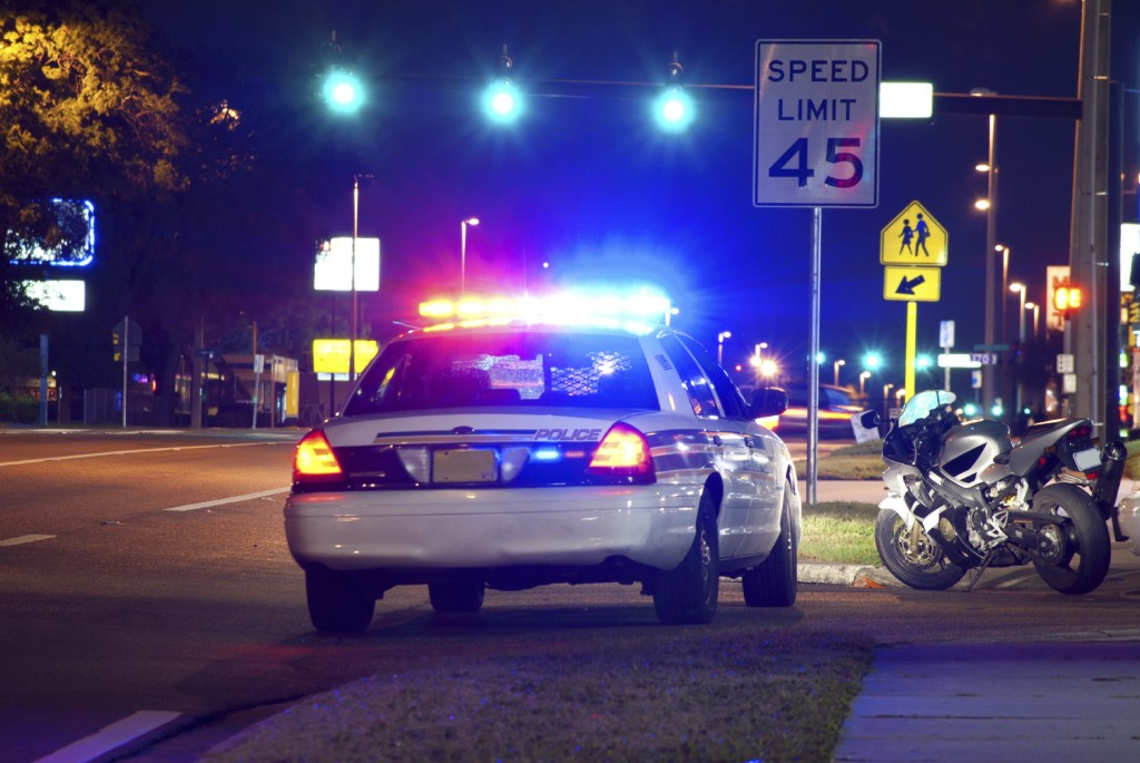 Motorcycle pulled over at night