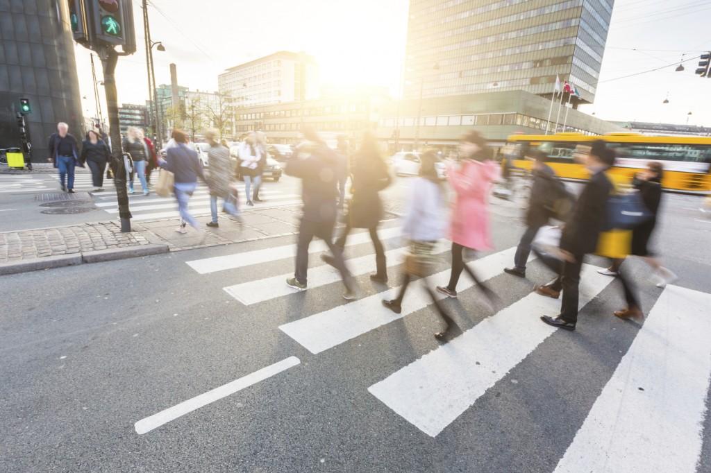 Blurred crowd of people walking on zebra crossing