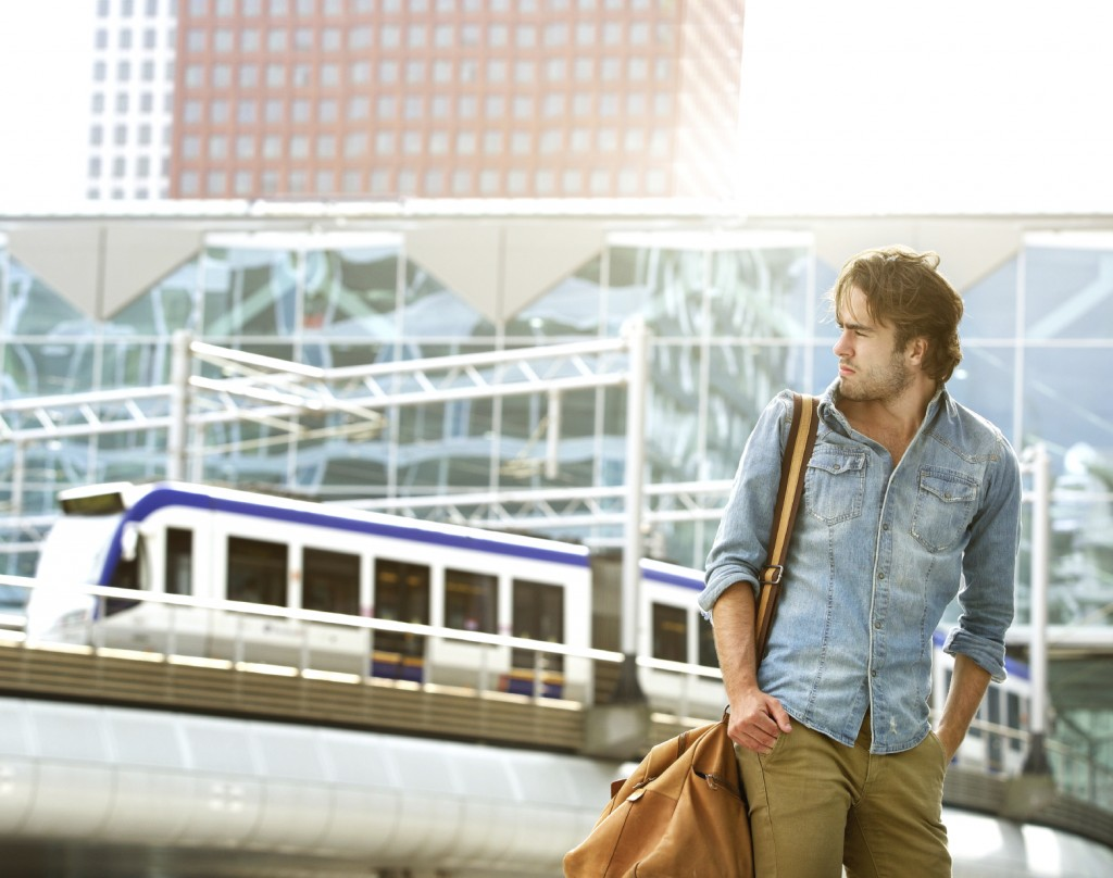young man traveling with bag