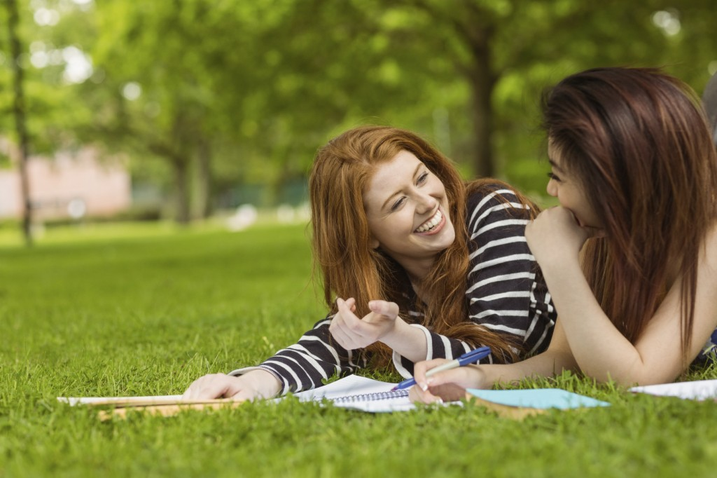 students with books in park