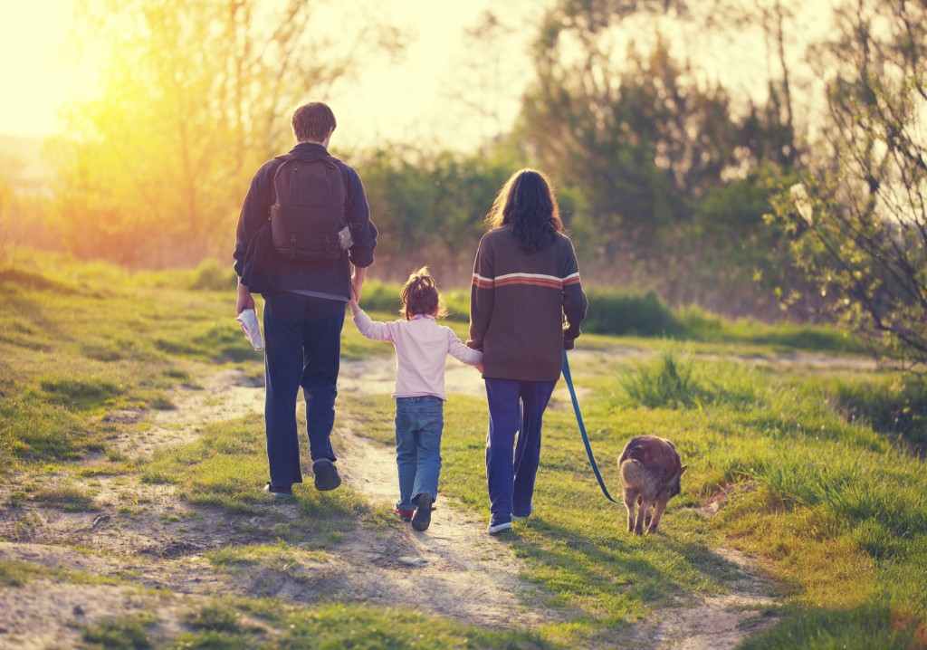 Family walking with dog