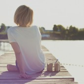 Girl sitting on a pier