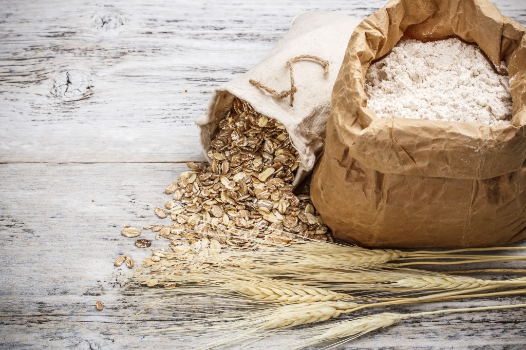 Oat flakes spilling from the burlap bag