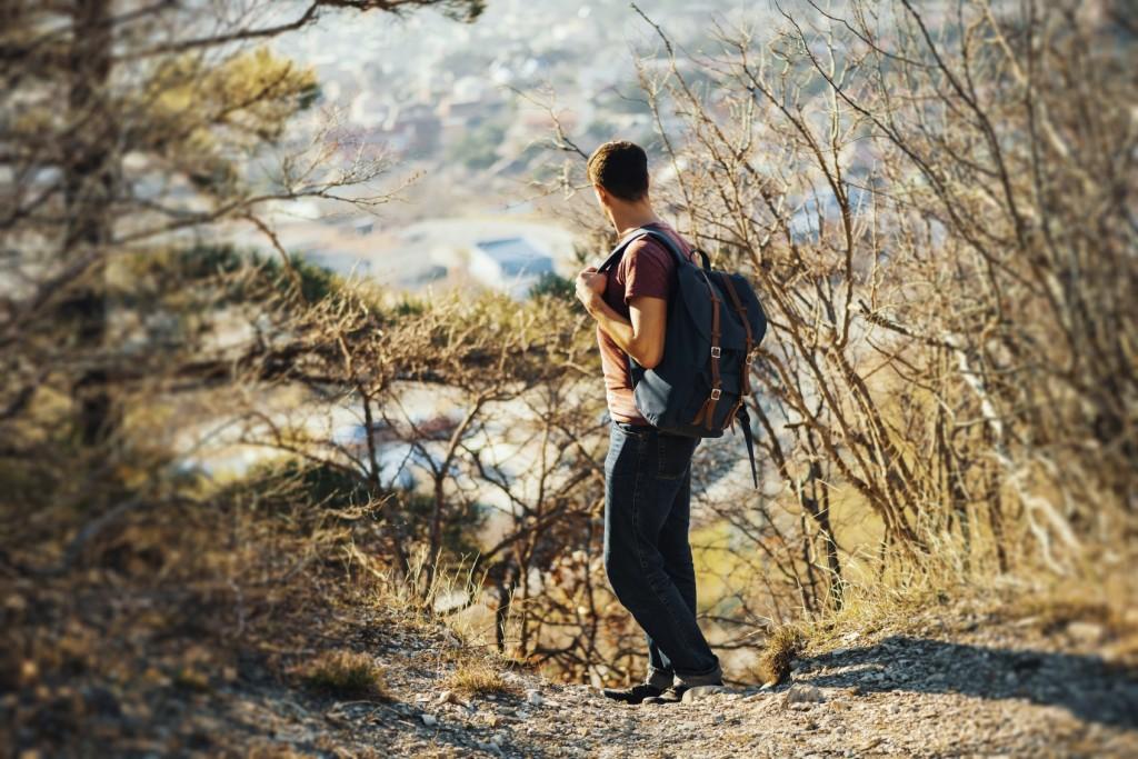 Hiker man looking back in highlands