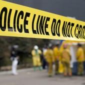 Police caution tape at crime scene