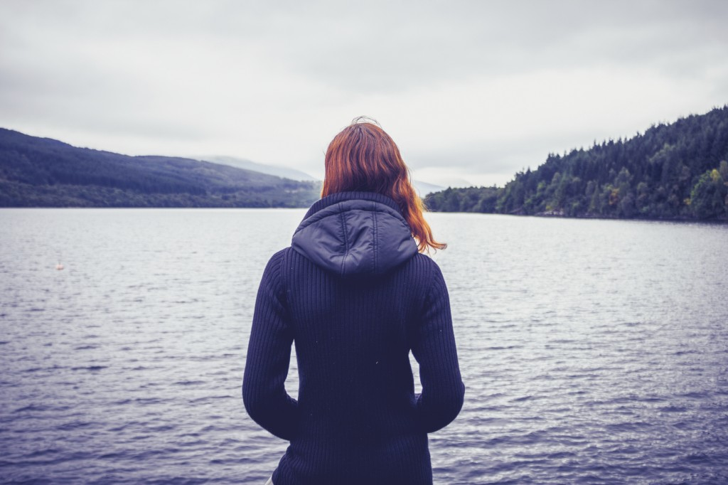 Woman admiring stillness of the lake
