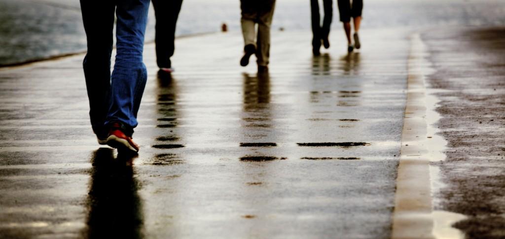People walking on a rainy walkway