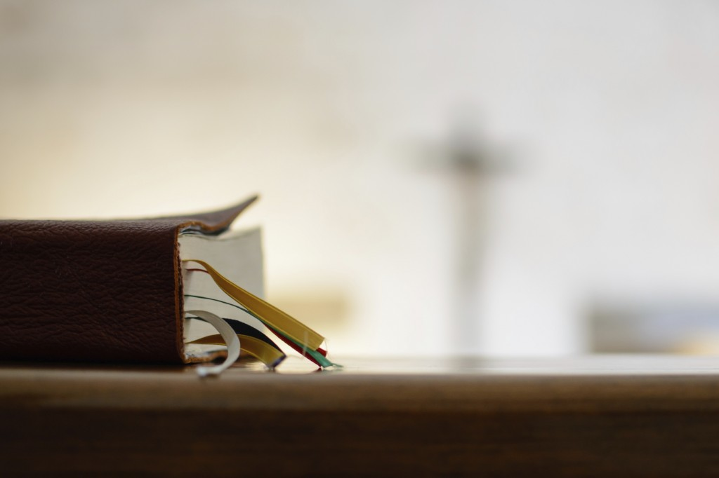 Bible on bench in church
