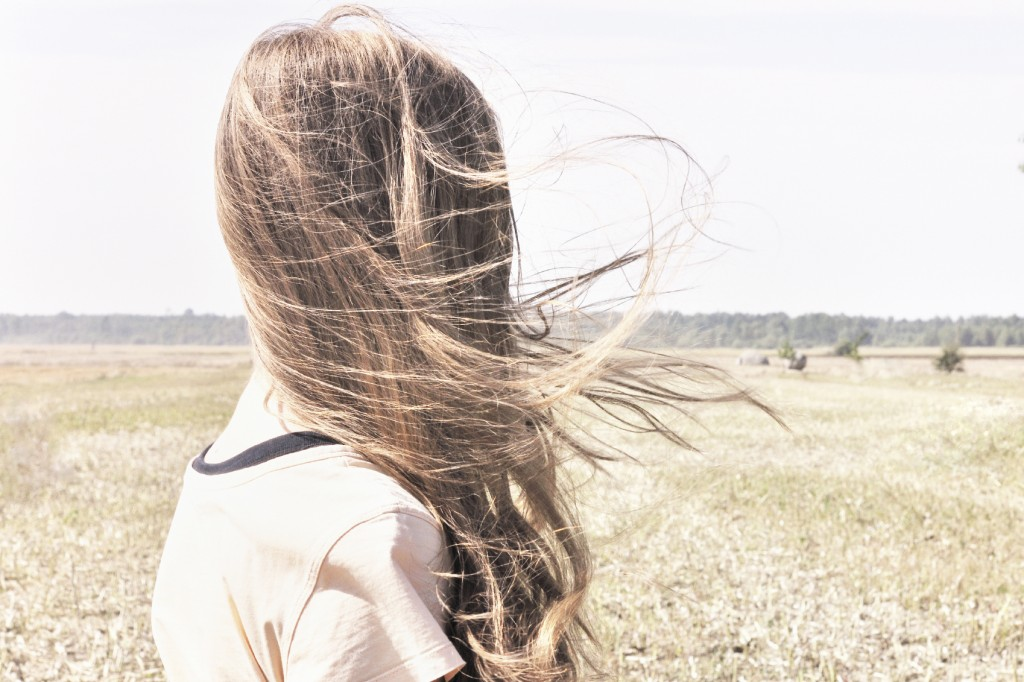 Wind whips through young girls hair