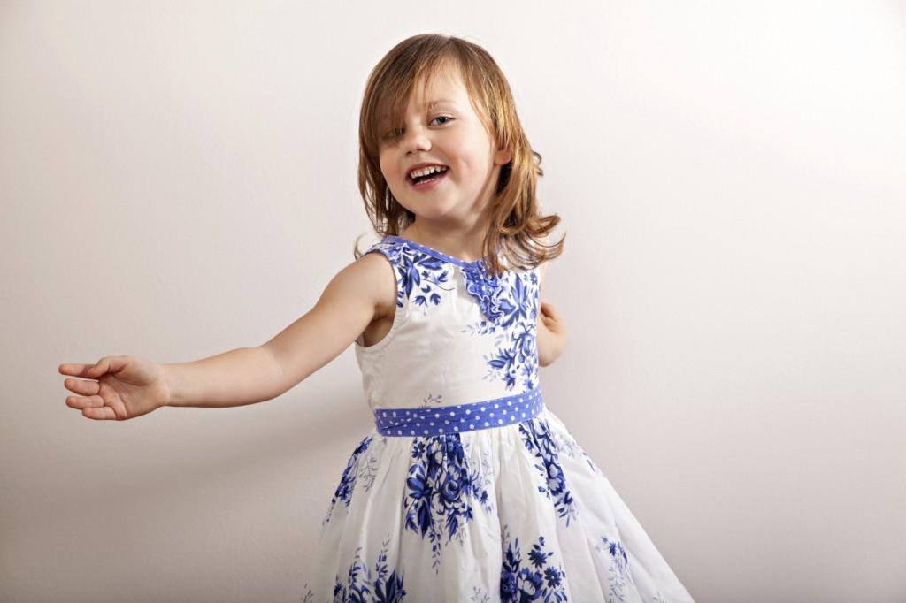 happy little girl in motion