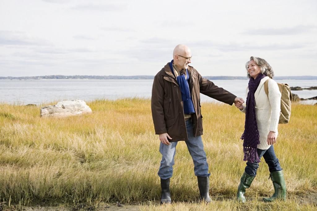 Mature couple walking on marshland