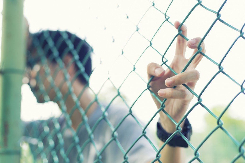 Man hold fence
