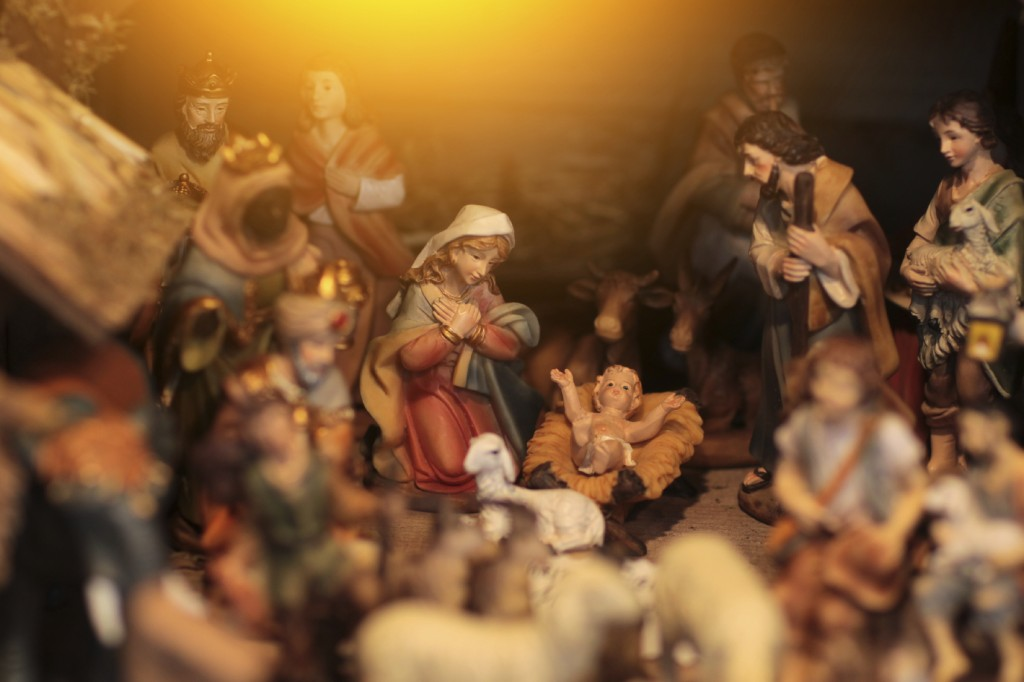 Christmas scene with figurines including Jesus, Mary, Joseph, king