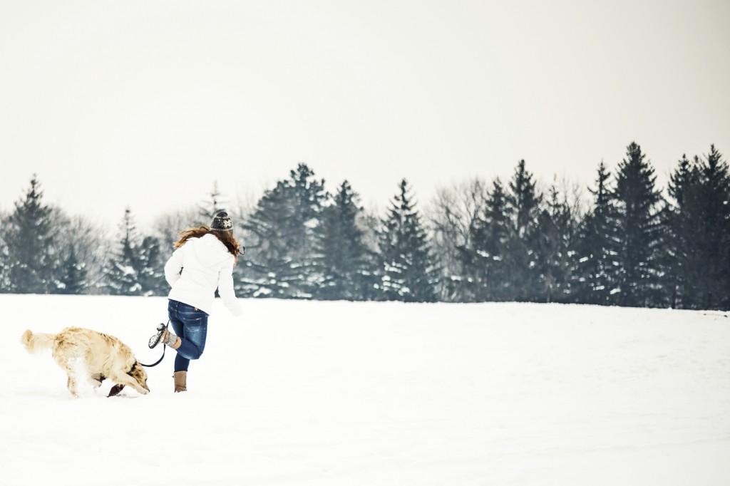 Women run with her dog