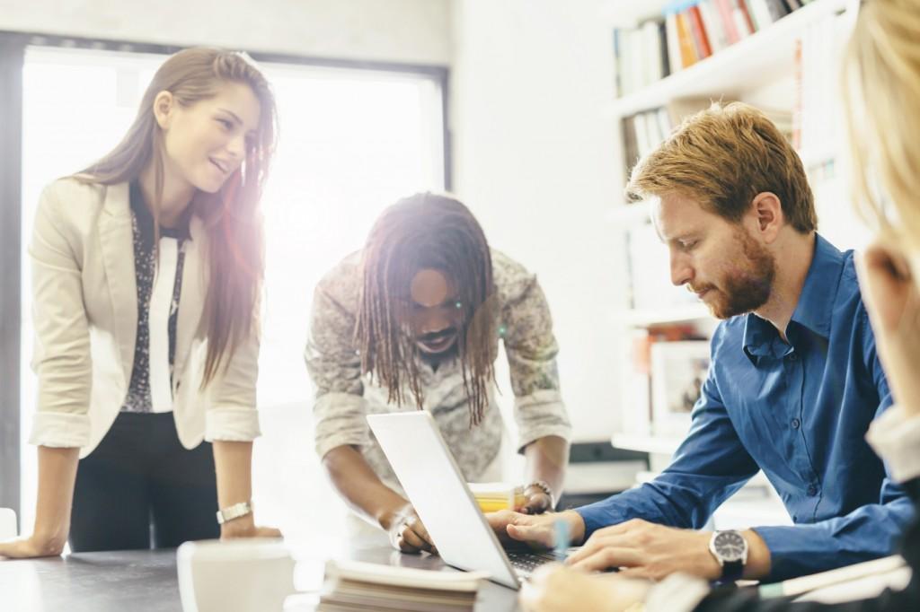 Coworkers brainstorming in office