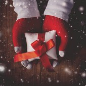 Christmas eve gift, hands giving wrapped present,