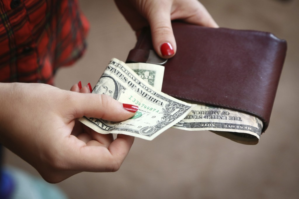 Paying with cash from a wallet