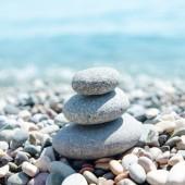 three stones on stack near sea