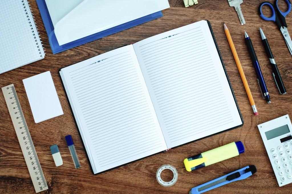 Office Supplies Neatly Organized Around Notebook